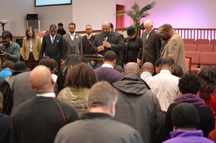 Mayor Finch joins prayer gathering at close of meeting.