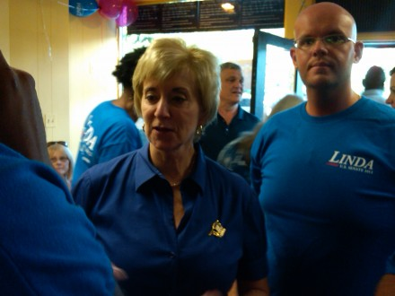 John Slater, right, with Linda McMahon at her U.S. Senate Bridgeport headquarters in 2012.