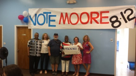 Moore supporters inside headquarters from left, Ed Gomes, Lisa Parziale, Pat Speer, Marilyn Moore, Mary-Jane Foster and Gabrielle Parisi.